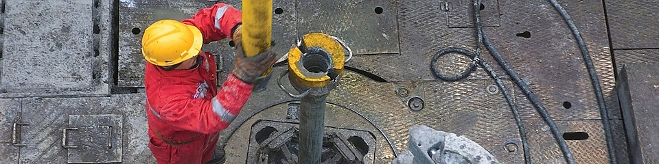 Man drilling in a rig